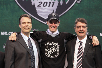 ST PAUL, MN - JUNE 24:  Seventh overall pick Mark Scheifele by the Winnipeg Jets stands at the podium with members of the Winnipeg Jets organization for a photo during day one of the 2011 NHL Entry Draft at Xcel Energy Center on June 24, 2011 in St Paul,