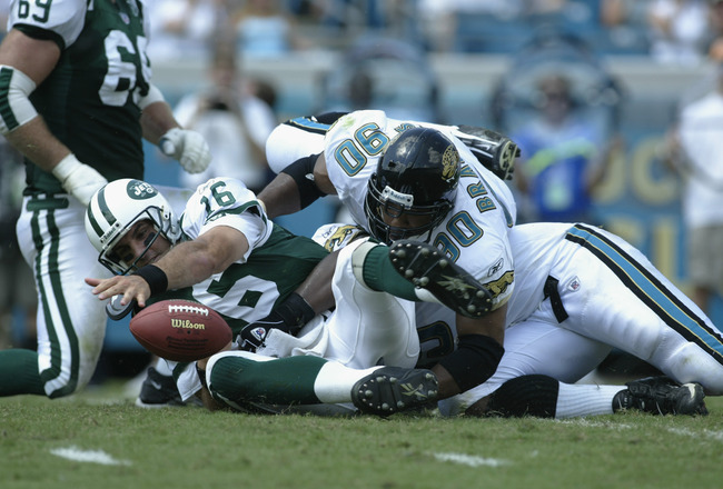 JACKSONVILLE, FL - SEPTEMBER 29:  Defensive end Tony Brackens #90 of the Jacksonville Jaguars lands on top of quarterback Vinny Testaverde #16 of the New York Jets during the NFL game on September 29, 2002 at Alltel Stadium in Jacksonville, Florida.  The