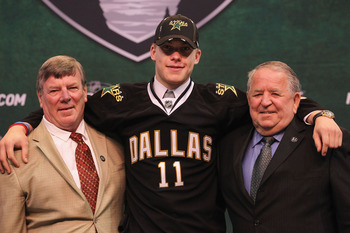 ST PAUL, MN - JUNE 24:  Fourteenth overall pick Jamieson Oleksiak by the Dallas Stars stands onstage for a photo with members of the Dallas Stars organization during day one of the 2011 NHL Entry Draft at Xcel Energy Center on June 24, 2011 in St Paul, Mi