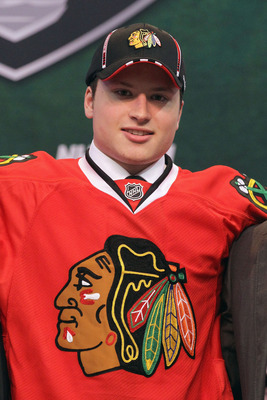ST PAUL, MN - JUNE 24:  Eighteenth overall pick Mark McNeill by the Chicago Blackhawks stands onstage for a photo during day one of the 2011 NHL Entry Draft at Xcel Energy Center on June 24, 2011 in St Paul, Minnesota.  (Photo by Bruce Bennett/Getty Image