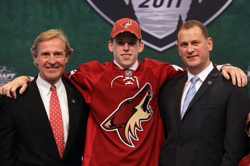 ST PAUL, MN - JUNE 24: 20th overall pick Connor Murphy by the Phoenix Coyotes stands onstage with General Manager Don Maloney and a member of the Phoenix Coyotes organization during day one of the 2011 NHL Entry Draft at Xcel Energy Center on June 24, 201