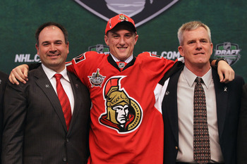 ST PAUL, MN - JUNE 24:  21st overall pick Stefan Noesen by the Ottawa Senators stands onstage for a photo with members of the Ottawa Senators organization during day one of the 2011 NHL Entry Draft at Xcel Energy Center on June 24, 2011 in St Paul, Minnes