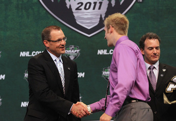 ST PAUL, MN - JUNE 24:  Head Coach Dan Bylsma of the Pittsburgh Penguins shakes hands with 23rd overall pick Joe Morrow during day one of the 2011 NHL Entry Draft at Xcel Energy Center on June 24, 2011 in St Paul, Minnesota.  (Photo by Bruce Bennett/Getty