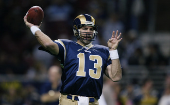 ST. LOUIS - NOVEMBER 18:  Quarterback Kurt Warner #13 of the St. Louis Rams throws a warm up pass before the game against the Chicago Bears at the Edward Jones Dome on November 18, 2002 in St. Louis, Missouri.  The Rams defeated the Bears 21-16.  (Photo b