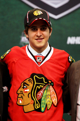 ST PAUL, MN - JUNE 24:  26th overall pick Phillip Danault by the Chicago Blackhawks stands onstage for a photo during day one of the 2011 NHL Entry Draft at Xcel Energy Center on June 24, 2011 in St Paul, Minnesota.  (Photo by Bruce Bennett/Getty Images)