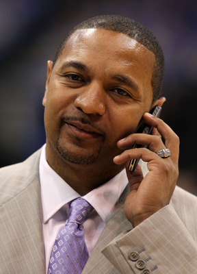 DALLAS, TX - JUNE 07:  ESPN NBA analyst Mark Jackson talks on the phone on the court before Game Four of the 2011 NBA Finals between the Dallas Mavericks and the Miami Heat at American Airlines Center on June 7, 2011 in Dallas, Texas. Jackson was named th