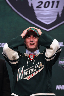 ST PAUL, MN - JUNE 24:  28th overall pick Zack Phillips by the Minnesota Wild stands onstage during day one of the 2011 NHL Entry Draft at Xcel Energy Center on June 24, 2011 in St Paul, Minnesota.  (Photo by Bruce Bennett/Getty Images)