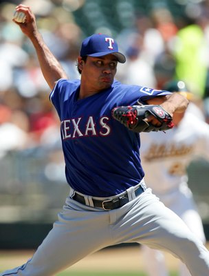 OAKLAND, CA - AUGUST 09:  Vincente Padilla #44 of the Texas Rangers pitches against the Oakland Athletics on August 9, 2006 at McAfee Coliseum in Oakland, California.  (Photo by Jed Jacobsohn/Getty Images)