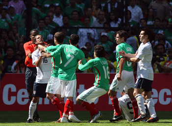 MEXICO CITY - AUGUST 12:  Benny Feilhaber #16 of the USA comes to the aide of teammate Charlie Davies #9 of the USA and is choked by Gerardo Torrado #6 of Mexico during the FIFA World Cup Qualifying soccer match between the USA and Mexico at Azteco Stadiu