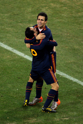 JOHANNESBURG, SOUTH AFRICA - JULY 11:  Xavi Hernandez and Francesc Fabregas of Spain celebrate winning the World Cup during the 2010 FIFA World Cup South Africa Final match between Netherlands and Spain at Soccer City Stadium on July 11, 2010 in Johannesb
