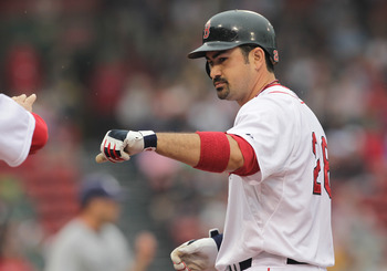 BOSTON, MA  - JUNE 22:  Adrian Gonzalez #28 of the Boston Red Sox reacts after he reaching base on the second of a four-hit game against the San Diego Padres at Fenway Park on June 22, 2011 in Boston, Massachusetts.  (Photo by Jim Rogash/Getty Images)