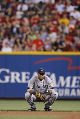 CINCINNATI, OH - JUNE 20: Robinson Cano #24 of the New York Yankees looks on during the game against the Cincinnati Reds at Great American Ball Park on June 20, 2011 in Cincinnati, Ohio. The Yankees defeated the Reds 5-3. (Photo by Joe Robbins/Getty Image