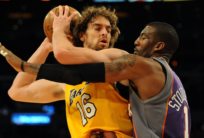 LOS ANGELES, CA - DECEMBER 10:  Pau Gasol #16 of the Los Angeles Lakers is defended by Amare Stoudemire #1 of the Phoenix Suns during the second half at the Staples Center on December, 10 2008 in Los Angeles, California.   NOTE TO USER: User expressly ack