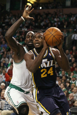 BOSTON, MA - JANUARY 21:  Paul Millsap #24 of the Utah Jazz heads for the net as Kevin Garnett #5 of the Boston Celtics defends on January 21, 2011 at the TD Garden in Boston, Massachusetts.  NOTE TO USER: User expressly acknowledges and agrees that, by d