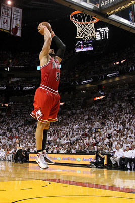 MIAMI, FL - MAY 24:  Carlos Boozer #5 of the Chicago Bulls dunks against the Miami Heat in Game Four of the Eastern Conference Finals during the 2011 NBA Playoffs on May 24, 2011 at American Airlines Arena in Miami, Florida. NOTE TO USER: User expressly a