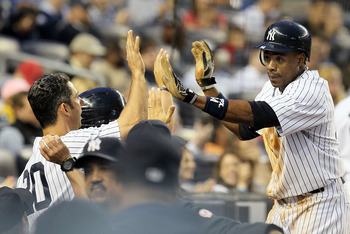 NEW YORK, NY - JUNE 24:  Curtis Granderson #14 of the New York Yankees celebrates with teammate Jorge Posada #20 after scoring a third inning run against the Colorado Rockies on June 24, 2011 at Yankee Stadium in the Bronx borough of New York City.  (Phot