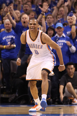 OKLAHOMA CITY, OK - MAY 23:  Russell Westbrook #0 of the Oklahoma City Thunder reacts in the first half while taking on the Dallas Mavericks in Game Four of the Western Conference Finals during the 2011 NBA Playoffs at Oklahoma City Arena on May 23, 2011