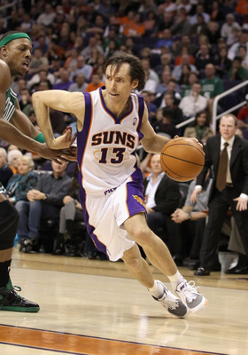 PHOENIX, AZ - JANUARY 28:  Steve Nash #13 of the Phoenix Suns drives the ball during the NBA game against the Boston Celtics at US Airways Center on January 28, 2011 in Phoenix, Arizona. The Suns defeated the Celtics 88-71. NOTE TO USER: User expressly ac