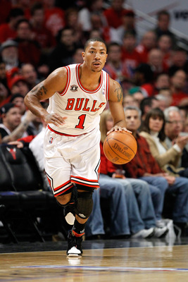 CHICAGO, IL - MAY 15:  Derrick Rose #1 of the Chicago Bulls brings the ball up court against the Miami Heat in Game One of the Eastern Conference Finals during the 2011 NBA Playoffs on May 15, 2011 at the United Center in Chicago, Illinois. The Bulls won