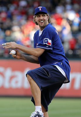 ARLINGTON, TX - JUNE 24:  Dirk Nowitzki of the 2011 NBA Champion Dallas Mavericks throws out the ceremonial first pitch before a game between the New York Mets and the Texas Rangers at Rangers Ballpark in Arlington on June 24, 2011 in Arlington, Texas.  (