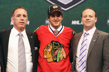 ST PAUL, MN - JUNE 24:  26th overall pick Phillip Danault by the Chicago Blackhawks stands onstage for a photo with General Manager Stan Bowman of the Chicago Blackhawks (R) during day one of the 2011 NHL Entry Draft at Xcel Energy Center on June 24, 2011