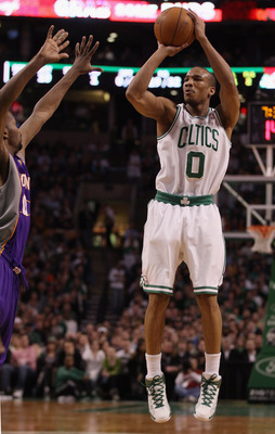BOSTON, MA - MARCH 02:  Avery Bradley #0 of the Boston Celtics takes a shot as Aaron Brooks #0 of the Phoenix Suns defends on March 2, 2011 at the TD Garden in Boston, Massachusetts.  NOTE TO USER: User expressly acknowledges and agrees that, by downloadi