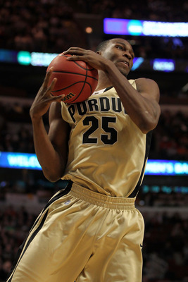 CHICAGO, IL - MARCH 20:  JaJuan Johnson #25 of the Purdue Boilermakers rebounds against the Virginia Commonwealth Rams n the first half during the third round of the 2011 NCAA men's basketball tournament at the United Center on March 20, 2011 in Chicago,