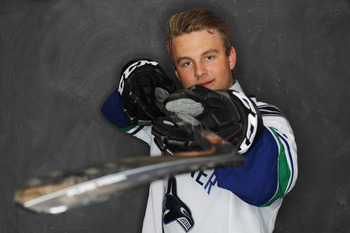 ST PAUL, MN - JUNE 24: (EDITORS NOTE: Image has been digitally altered.)  29th over pick Nicklas Jensen by the Vancouver Canucks poses for a portrait during day one of the 2011 NHL Entry Draft at Xcel Energy Center on June 24, 2011 in St Paul, Minnesota.