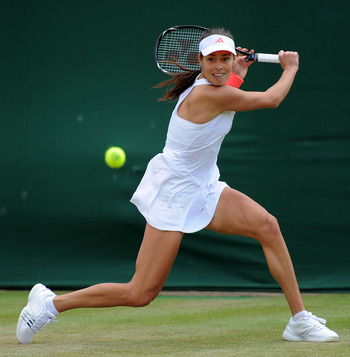 LONDON, ENGLAND - JUNE 23:  Ana Ivanovic of Serbia lines up a shot during her second round match against Eleni Danilidou of Greece on Day Four of the Wimbledon Lawn Tennis Championships at the All England Lawn Tennis and Croquet Club on June 23, 2011 in L