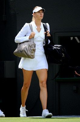 LONDON, ENGLAND - JUNE 24:  Maria Sharapova of Russia walks out on court before her second round match against  Laura Robson of Great Britain on Day Five of the Wimbledon Lawn Tennis Championships at the All England Lawn Tennis and Croquet Club on June 24