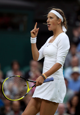 LONDON, ENGLAND - JUNE 24:  Victoria Azarenka of Belarus celebrates winning her third round match against Daniela Hantuchova of Slovakia on Day Five of the Wimbledon Lawn Tennis Championships at the All England Lawn Tennis and Croquet Club on June 24, 201