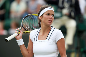 LONDON, ENGLAND - JUNE 25:  Julia Goerges of Germany reacts during her third round match against Dominika Cibulkova of Slovakia  on Day Six of the Wimbledon Lawn Tennis Championships at the All England Lawn Tennis and Croquet Club on June 25, 2011 in Lond