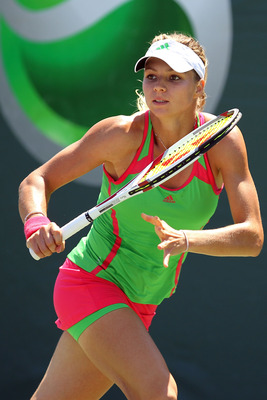KEY BISCAYNE, FL - MARCH 25:  Maria Kirilenko readies for a return against Sania Mirza of India during the Sony Ericsson Open at Crandon Park Tennis Center on March 25, 2011 in Key Biscayne, Florida.  (Photo by Al Bello/Getty Images)