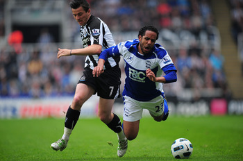 NEWCASTLE UPON TYNE, ENGLAND - MAY 07:  Newcastle player Joey Barton (l) challenges Jean Beausejour of Birmingham during the  Barclays Premier League game between Newcastle United and Birmingham City at St James' Park on May 7, 2011 in Newcastle upon Tyne