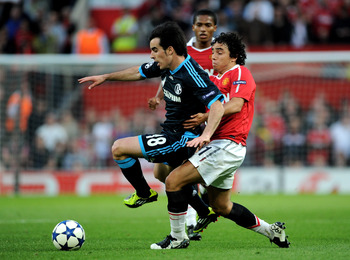 MANCHESTER, ENGLAND - MAY 04:  Rafael of Manchester United challenges Jose Manuel Jurado of Schalke during the UEFA Champions League Semi Final second leg match between Manchester United and Schalke at Old Trafford on May 4, 2011 in Manchester, England.