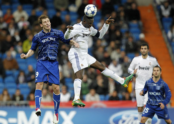 MADRID, SPAIN - DECEMBER 08: Mahamadou Diarra of Real Madrid jumps for a high ball with Valter Birsa of AJ Auxerre during the Champions League group G match between Real Madrid and AJ Auxerre at Estadio Santiago Bernabeu on December 8, 2010 in Madrid, Spa