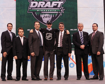 ST PAUL, MN - JUNE 24:  Seventh overall pick Mark Scheifele by the Winnipeg Jets stands at the podium for a photo with members of the Winnipeg Jets organization during day one of the 2011 NHL Entry Draft at Xcel Energy Center on June 24, 2011 in St Paul,