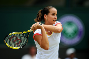 LONDON, ENGLAND - JUNE 25:  Jarmila Gajdosova of Australia in action during her third round match against Caroline Wozniacki of Denmark on Day Six of the Wimbledon Lawn Tennis Championships at the All England Lawn Tennis and Croquet Club on June 25, 2011