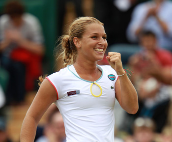 LONDON, ENGLAND - JUNE 25:  Dominika Cibulkova of Slovakia celebrates after winning her third round match against Julia Goerges of Germany on Day Six of the Wimbledon Lawn Tennis Championships at the All England Lawn Tennis and Croquet Club on June 25, 20