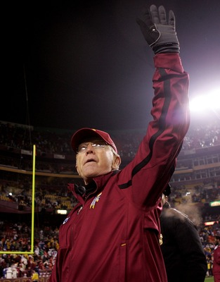 LANDOVER, MD - DECEMBER 30:  Washington Redskins head coach Joe Gibbs walks from the field after defeating the Dallas Cowboys on December 30, 2007 at FedEx Field in Landover, Maryland.  (Photo by Nick Laham/Getty Images)