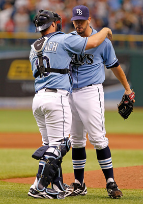 ST. PETERSBURG, FL - JUNE 19:  Catcher Kelly Shoppach #10 hugs pitcher James Shields #33 of the Tampa Bay Rays after his complete game victory over the Florida Marlins at Tropicana Field on June 19, 2011 in St. Petersburg, Florida.  (Photo by J. Meric/Get