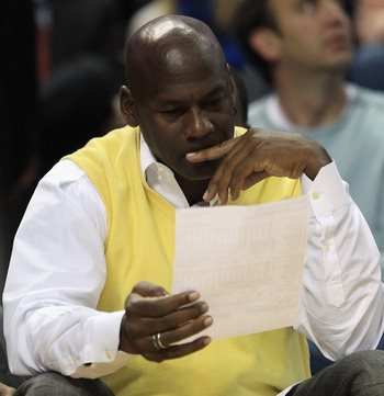 CHARLOTTE, NC - FEBRUARY 25:  Owner of the Charlotte Bobcats, Michael Jordan watches on during their game against the Sacramento Kings at Time Warner Cable Arena on February 25, 2011 in Charlotte, North Carolina. NOTE TO USER: User expressly acknowledges
