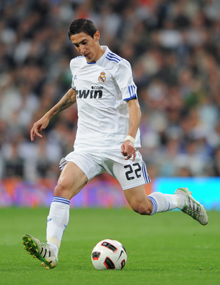 MADRID, SPAIN - APRIL 16:  Angel Di Maria of Real Madrid strikes the ball during the la Liga match between Real Madrid and Barcelona at Estadio Santiago Bernabeu on April 16, 2011 in Madrid, Spain.  (Photo by Jasper Juinen/Getty Images)