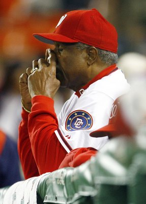 WASHINGTON - SEPTEMBER 30:  Manager Frank Robinson #20 of the Washington Nationals reacts during the game against the New York Mets on September 30, 2006 at RFK Stadium in Washington, DC.  (Photo by Jamie Squire/Getty Images)