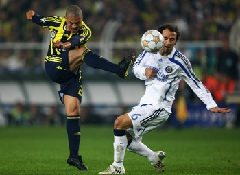 ISTANBUL, TURKEY - APRIL 02:  Alex of Fenerbahce shoots on goal as Ricardo Carvalho of Chelsea attempts the block during the UEFA Champions League Quarter Final 1st Leg match between Fenerbache and Chelsea at the Sukru Saracoglu Stadium on April 2, 2008 i