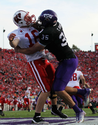 PASADENA, CA - JANUARY 01:  Quarterback Scott Tolzien #16 of the Wisconsin Badgers is hit by linebacker Tanner Brock #43 of the TCU Horned Frogs during the 97th Rose Bowl game on January 1, 2011 in Pasadena, California.  (Photo by Stephen Dunn/Getty Image