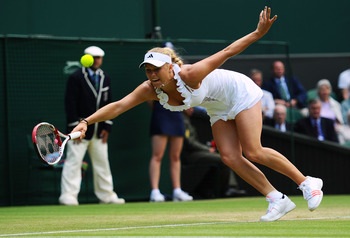 LONDON, ENGLAND - JUNE 25:  Caroline Wozniacki of Denmark  reaches for a shot during her third round match against Jarmila Gajdosova of Australia on Day Six of the Wimbledon Lawn Tennis Championships at the All England Lawn Tennis and Croquet Club on June