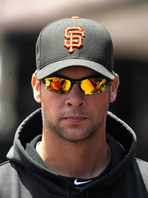 SAN FRANCISCO, CA - JUNE 08:  Ryan Vogelsong #32 of the San Francisco Giants stands in the dugout before their game against the Washington Nationals at AT&T Park on June 8, 2011 in San Francisco, California.  (Photo by Ezra Shaw/Getty Images)