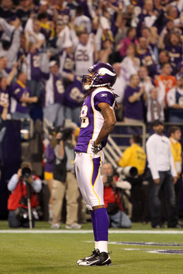 MINNEAPOLIS - JANUARY 17:  Wide receiver Sidney Rice #18 of the Minnesota Vikings celebrates his touchdown against the Dallas Cowboys during the second quarter of the NFC Divisional Playoff Game at Hubert H. Humphrey Metrodome on January 17, 2010 in Minne