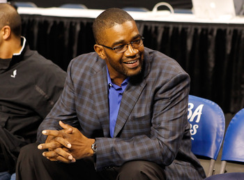 TAMPA, FL - OCTOBER 22:  General Manager Otis Smith of the Orlando Magic smiles on the bench before the game against the Miami Heat was cancelled at the St. Pete Times Forum on October 22, 2010 in Tampa, Florida.  NOTE TO USER: User expressly acknowledges